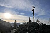 Mountain cross under the Kampenwand, Chiemgau, Upper Bavaria, Bavaria, Germany