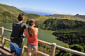 Young couple enjoying the view, Caldeira Funda, Island of Flores, Azores, Portugal