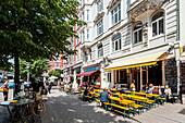 People sitting in street cafes in Hamburg Schanzenviertel, Hamburg, Germany