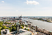 View to Hamburg harbour with the Elbphilharmonie and the Landungsbruecken, Hamburg, Germany