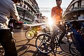 Cyclo Drivers on Busy Street, Phnom Penh, Cambodia