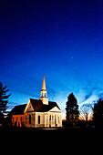 Illuminated Church at Sunset
