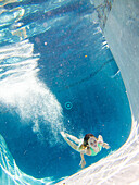 Girl Underwater in Pool After Diving