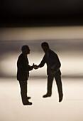 Businessmen Figurines Shaking Hands