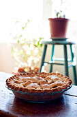 Baked Apple Pie With Plants in Background