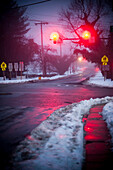 Red Traffic Lights and Snowy Street