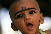 A Child Wearing Kajal Make-Up, A Natural Black-Coloured Balm, Both Make-Up And Eye Care, Nedungolam, Kerala, Southern India