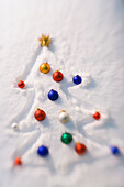 Christmas Tree Outlined In A Fresh Blanket Of Snow With Multi-Colored Bulb Ornaments Covering Tree And Gold Star At Top Winter Alaska