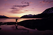 Woman Hiking Along Turnagain Arm At Sunset Spring Ak