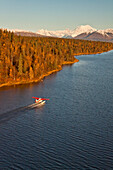 A Cessna 185 Floatplane Lands On An Unnamed Lake With Mt. Mckinley And Alaska Range In Background, Southcentral Alaska Fall