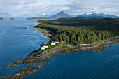Aerial View Of Point Retreat Light House At The Tip Of Mansfield Penninsula With Admiralty Island In The Background, Southeast, Alaska