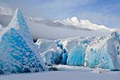 Closeup Of Blue Ice & Icebergs Frozen In Mendehall Lake W/Glacier Southeast Alaska Winter