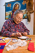 Native Female Yupik Elder Sitting @ Kitchen Table Doing Beadwork Akiachak Western Alaska Indoors
