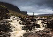 'Water Cascading Over Rocks Under Storm Clouds; Applecross Peninsula Scotland'