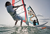 'Two windsurfers side by side in the water; tarifa cadiz andalusia spain'