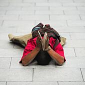 'China, Xizang, Tibet, Male Pilgrim Laying in Prayer; Lhasa'