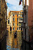 'Italy, Rowing Gondola Through Canal; Venice'