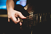 'Close-Up Of Guitar Player's Hand Holding Pick And Strumming Strings;Montreal Quebec Canada'