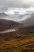'A Recreational Vehicle Drives On Dempster Highway Past Klondike Valley In Tombstone Territorial Park;Yukon Canada'