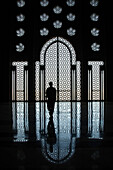 'Morocco, Silhouette Of Person Standing In Front Of Ornate Wall In Hassan Ii Mosque With Reflection On Shiny Floor; Casablanca'