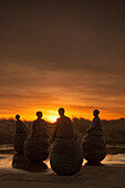 'Uk, England, Tyne And Wear, Four Female Statues At Sunset; South Shields'