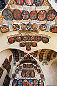 'Czech Republic, Colorful Crests Displayed On Curved Ceiling And Walls; Prague'