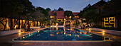 'Thailand, An Outdoor Swimming Pool In The Evening At The Horizon Village Resort And Convention Center; Chiang Mai'