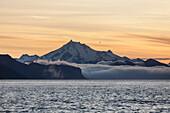 Frosty Peak on the Alaska Peninsula from Ikatan Bay near False Pass, Southwest Alaska, summer.