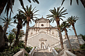 Steps lined with palm trees to the impressive Church of the Birth of our Lady, Prcanj, Bay of Kotor, Adriatic coastline, Montenegro, Western Balkan, Europe