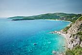 High angle view of turquoise blue water along the coastline at Budva, Adriatic coastline, Montenegro, Western Balkan, Europe