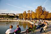 People resting in Jardin des Tuileries, Paris, France