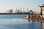 View of Sheikh Zayed Grand Mosque from infinity pool, Shangri-la Hotel, Abu Dhabi, United Arab Emirates