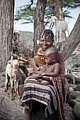 Portrait of traditionally dressed Turkana woman and child, Loyangalani, Kenya