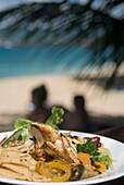 BBQ'd prawns with salad, The Aquarium Restaurant, Point Salines Beach, Grenada. © Ian Cumming / Axiom