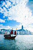 Traditional Chinese Junk boat, converted for tourists rides around harbor, Victoria Harbor, Hong Kong Island, China