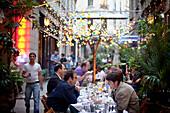 Turkey, Istanbul, People in restaurant at Sofyali Sokak, Beyoglu district