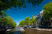 Cruise boats going up and down canal, Amsterdam, Holland
