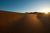 Sand dune at dawn near Merzouga in Sahara Desert, Erg Chebbi, Morocco
