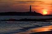 The beaches of the Atlantic Coast of southern Spain - the Costa de La Luz.The lighthouse of Cabo (Cape) Trafalgar at sunset.  Andalucia, Spain  © James Sparshatt / Axiom