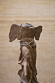 Winged victory statue of Nike of Samothrace in Louvre Museum, Paris, France