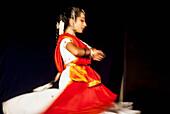 India, Karnataka, Young girl dancing in traditional dress, Udupi