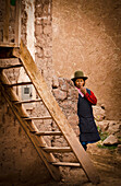 Alex, Adams, Outdoors, Day, Portrait, Looking At Camera, Front View, Full Length, Head In Hands, Standing, Mature Women, One Person, Building Exterior, Architecture, Street, Real People, City Life, Simplicity, Tranquility, Peru, Cuzco, Hat, Stairs, Stone