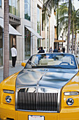 Paul, Quayle, Outdoors, Day, Front View, Incidental People, Building Exterior, Architecture, Street, Transportation, Car, Palm Tree, Wealth, Luxury, California, USA, Yellow, Lighting Equipment, Shiny, Vibrant Color, Limousine, Convertible, City Life, Open