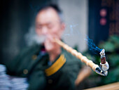 Alex, Adams, Indoors, Waist Up, Focus On Foreground, Sitting, Holding, Mature Men, One Person, Relaxation, Indulgence, China, Pipe, Smoking, Smoke, Hobbies, Unhealthy Lifestyle, Smoking Issues, Inside, Interior, Interiors, Half Length, Male, People, One P