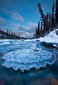 Sunset Over Ice-Covered Rock In Wheaton River, Yukon Canada