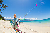 Hawaii, Maui, Professional Kiteboarder Susi Mai preparing to surf off the North Shore. EDITORIAL USE ONLY.
