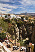 Landscape with buildings on edge of El Tajo gorge, Ronda, Spain