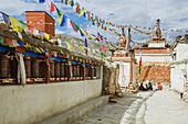 View of stupas, prayer flag and prayer wheels, Lo Manthang, Upper Mustang, Nepal
