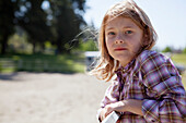 7-year-old girl in plaid shirt outdoors, Langley british columbia canada