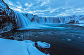 Godafoss with large pieces of ice forming in the cold weather, Iceland